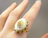 Vintage Avon locket ring with floral cameo, adjustable up to size 7.5