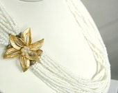 Long vintage white glass seed beaded necklace with gold flower clasp