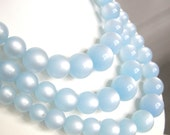 Vintage triple strand sky blue thermoset Lucite beaded necklace