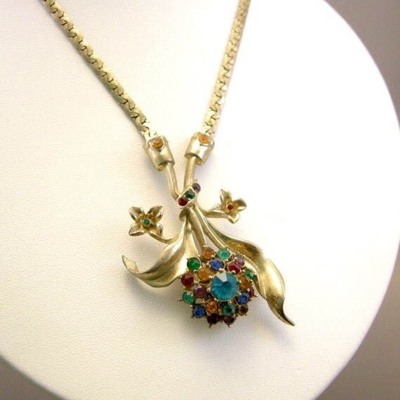 Vintage gold tone necklace with floral spray pendant and multi color rhinestones