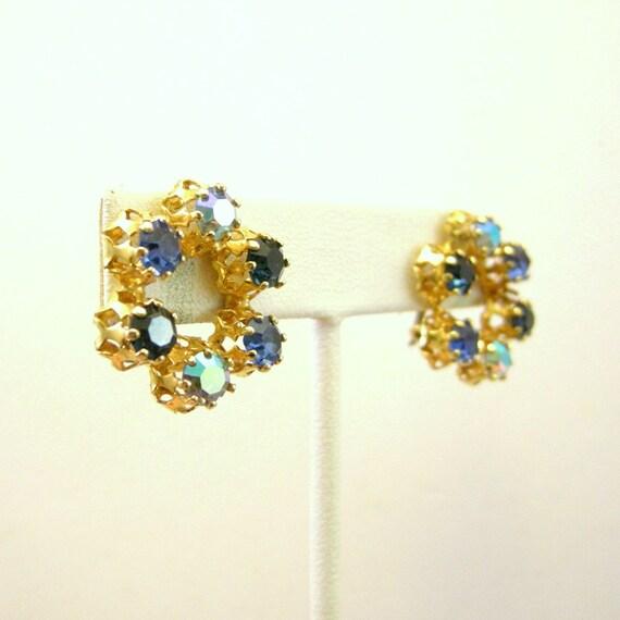 Vintage gold tone clip on earrings with blue rhinestones, aurora borealis