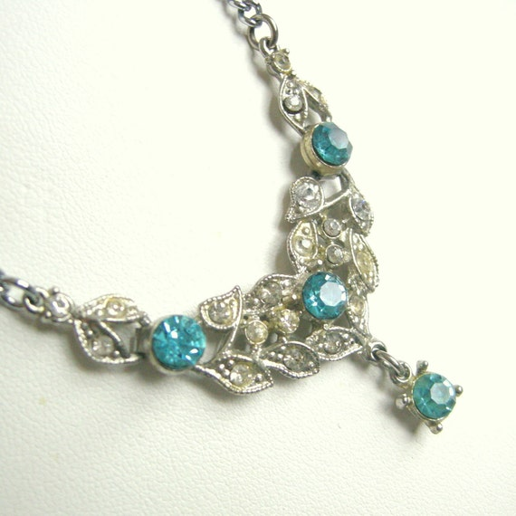 Vintage Art Deco style silver pot metal necklace with blue, white rhinestones