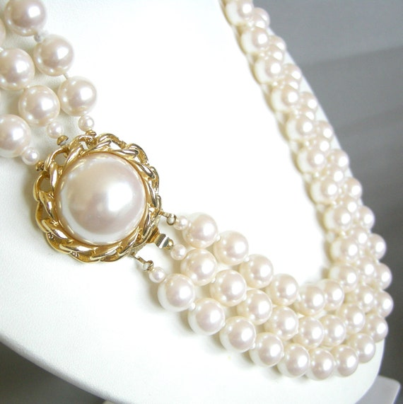 Vintage triple strand cream faux pearl necklace with gold chain clasp