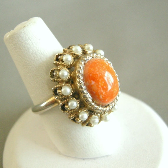 Vintage gold tone adjustable cocktail ring with faux pearls and orange cab