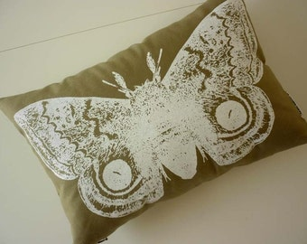 Giant IO Moth silk screened cotton canvas throw pillow 12x18 white on khaki