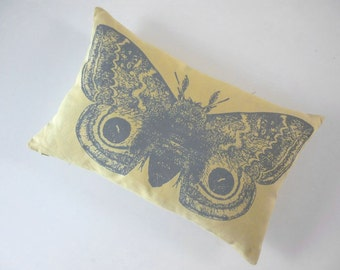 IO Moth silk screened cotton canvas throw pillow 12x18 gray on light yellow canvas
