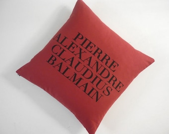 "Iconic Haute Couture Designer Name silk screened cotton canvas throw pillow 18"" red/black"