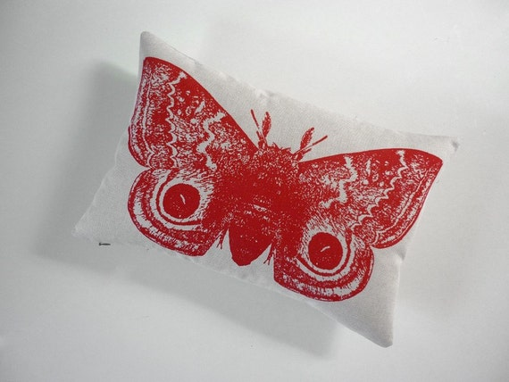 Giant IO Moth silk screened cotton canvas throw pillow 12x18 red