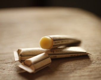 Rosewood lip embellishment with beeswax, cocoa butter, shea butter, forest-inspired natural flavor, eco friendly compostable tube