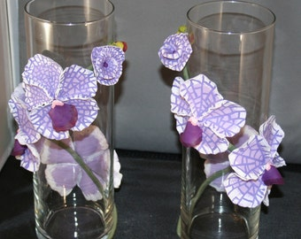 Purple polymer clay orchids on a  set of cylinder vases