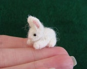 RESERVED A tiny white spring bunny
