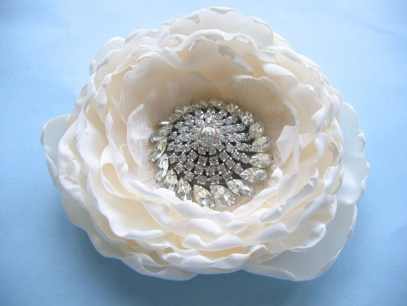Large floral hair clip or sash pin with vintage rhinestone brooch center, sparkling flower