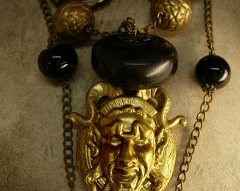 BIzarre Devil locket with bone and glass Goth beaded necklace