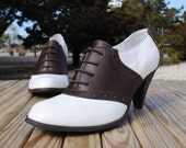 Vintage 1980s Lace Up High Heel Oxford Saddle Shoes in Brown and White Leather, size 9