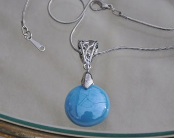 Floating turquoise glass drop necklcae