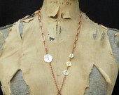 vintage buttons on a copper chain with  dressform pendant necklace