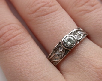 Moissanite palladium band with floral vines and diamonds
