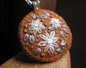 embroidered necklace in burnt orange. modern felt necklace. splurge.