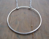 modern sterling silver necklace. simple circle necklace. geometric necklace. splurge.