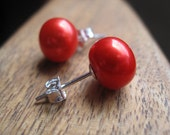 tangerine pearl earrings. neon orange red pearl stud earrings in sterling silver. silver earrings. post earrings. splurge.