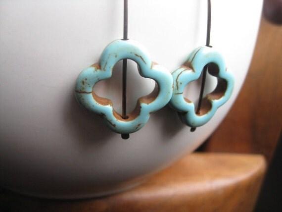 boho niobium earrings with turquoise howlite stones. tribal and handmade by splurge.