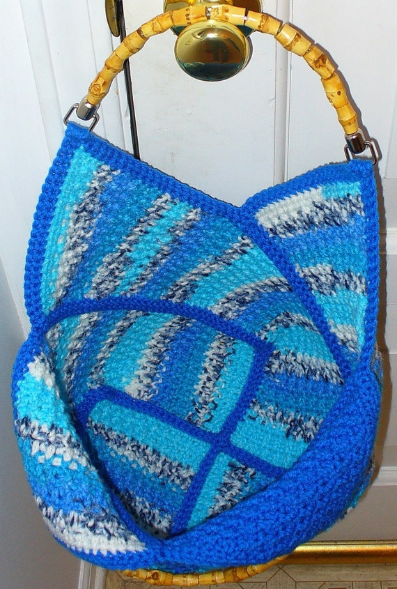 Blue windmill bag with wooden handles crocheted by MirandaCrochet