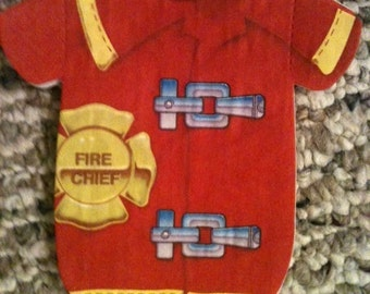 Any quantity firefighter napkins for baby shower or baby's first birthday.  In the shape of baby shirt or a bib.