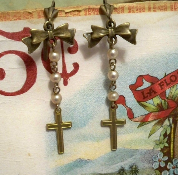 cross and bows dangle on vintage pearl chain