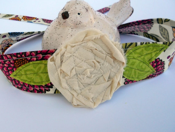 Beautiful Fabric Flower Headband in a summery fabric with pink, yellow and blue mums and lime green leaves