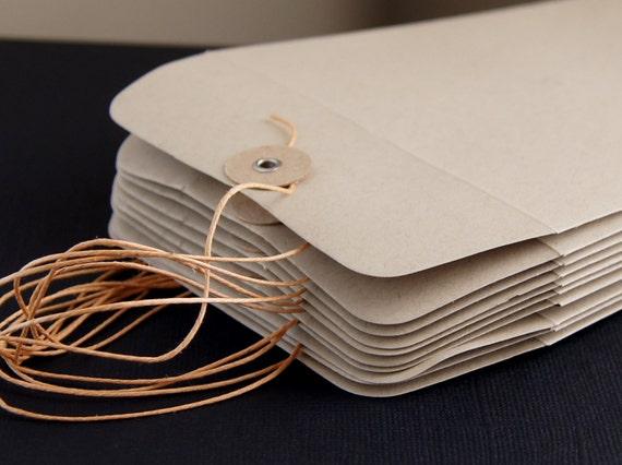 "10 String & Button Envelopes . Number 10 Size (4 1/8"" x 9 1/2"") in Paper Bag"