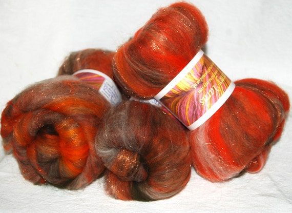 Hand carded smooth and glitzy batts with cream Alpaca and lot's of sparkle 100g