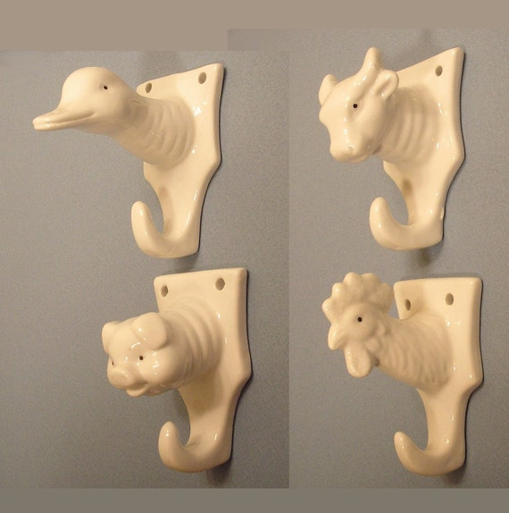 Set of Four Vintage White Porcelain Animal Hooks