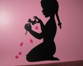 Silhouette of young girl with flower petals - vinyl wall design