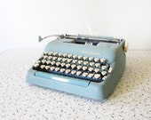 1950s blue smith corona typewriter / super silent typewriter with carrying case