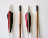 vintage wooden arrows / black and red arrows