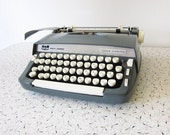 slate blue smith corona typewriter / 1960s super-sterling portable typewriter with carrying case