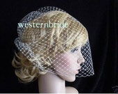 Ivory Birdcage veil . Full veil made with Russian net . With comb ready to wear.