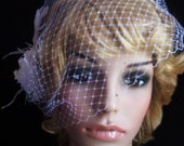 Beautiful Bridal WHITE Russian face veil. Bandeau style with combs on each side. Comes with fascinator.