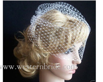 """Ivory birdcage veil 12"""" goes til the pick of the nose. with swarovski crystals on the edge."""