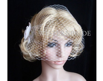 Elegant Orchid with VEIL WHITE Bandeau Style Birdcage Veil with Swarovski Crystals and Orchid Fascinator. brand new