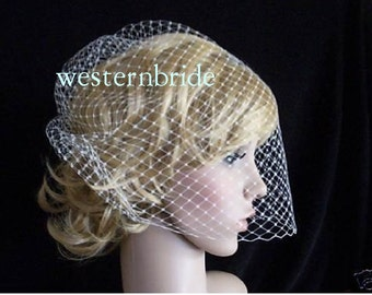 Best seller On Sale Ivory Birdcage veil . Full veil made with Russian net . With comb ready to wear.