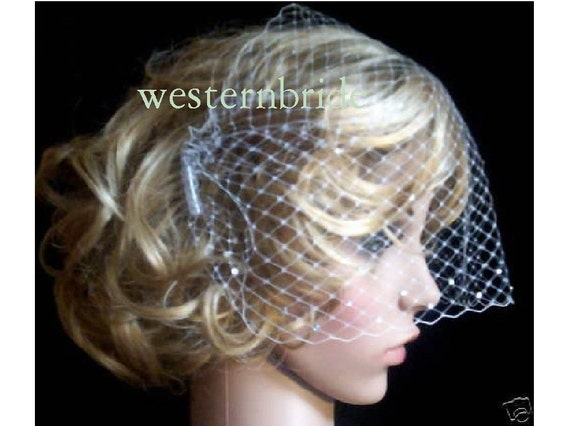 Ivory Veiling wedding Russian net. Bandeau Style with Swarovski crystals. Brand new with combs on each side. Ready to wear.