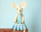 White mouse plush in matchbox bed