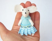 White mouse plush in matchbox bed patterned gingham blue
