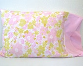 pair of vintage pink and green flowered pillowcases