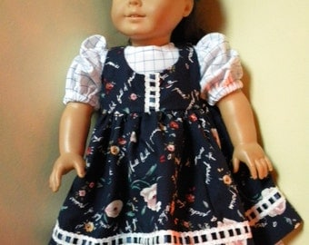White and navy dress and pinafore for 18 inch doll