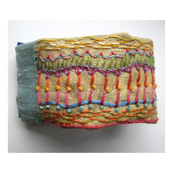 Hand Embroidered Multi-Colored Cuff with Orange Buttons