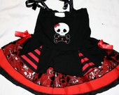 Girls black and red tutu princess pirate dress ,black red stripe insert and skull with doted bones embroidery at front.12 months to 6 years