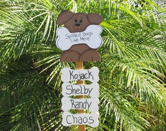 Personalized spoiled dogs live here garden stake