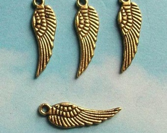 20 tiny wing charms, gold tone, 17mm